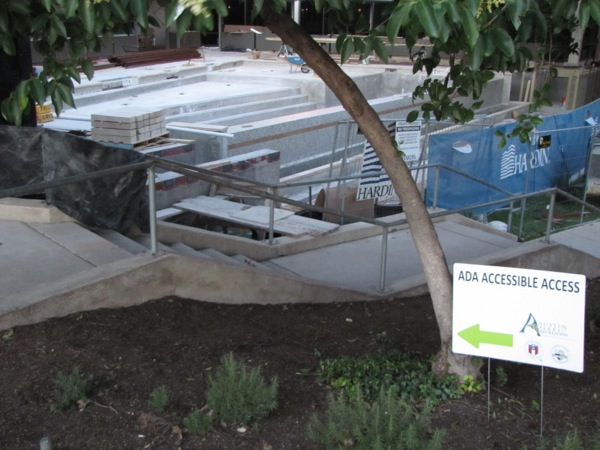 sign saying ADA access with arrow pointing to steps